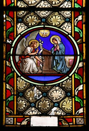 blessed virgin mary: Stained glass window in St.Victor church ( Castellane, France), depicting  St.Gabriel who announce the Blessed Virgin Mary Gods plan for her to be the Mother of His Son, Jesus.