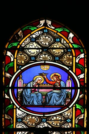 bible flower: Stained glass window in St.Victor church (Castellane, France), depicting Jesus Christ and St. Mary.