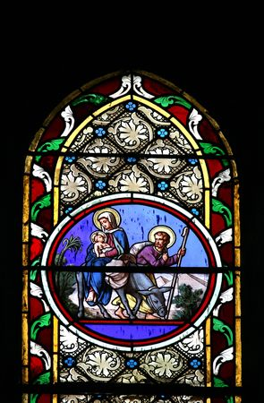Stained glass window in St.Victor church (Castellane, France) depicting the Holy Family.