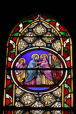 blessed virgin mary: Stained glass window in St.Victor church (Castellane, France) depicting a biblical scene: St. Mary visiting St. Elisabeth.  Stock Photo