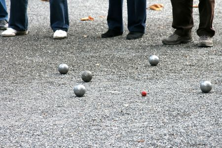 french boule: Traditional game with metal balls in France- jeu de boules (petanque) � selective focus.