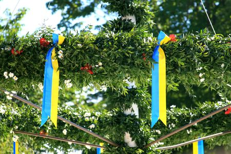 Close-up details of a traditional Swedish maypole- celebrated at Midsummer Day. photo
