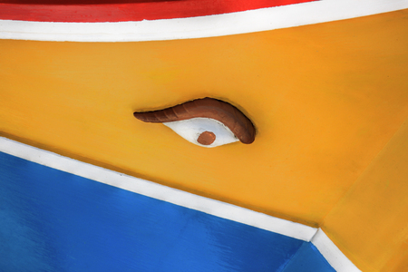 Close-up details of a painted eye on a traditional malteze fishing boat, luzzu.