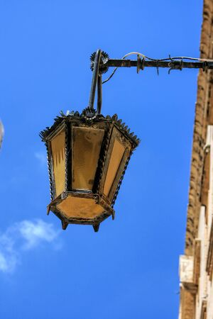 Close-up details of a medieval street lamp in Malta.