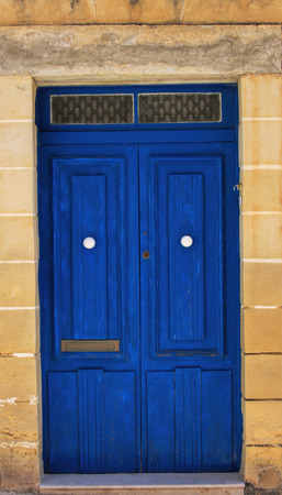 Details of a blue front door in Malta.