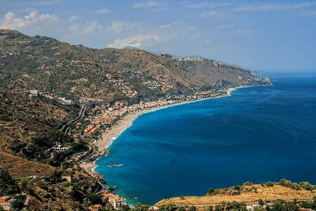 Bird-view details of the sea coast from Taormina Sicily, Italy. Stock Photo