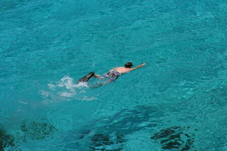 blue lagoon: Young boy snorkeling in crystal clear water of Blue Lagoon Comino,Malta.
