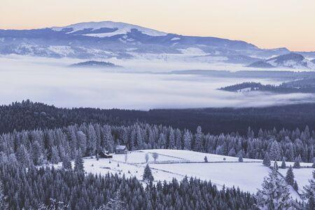 Low fog below Giumalau Massif