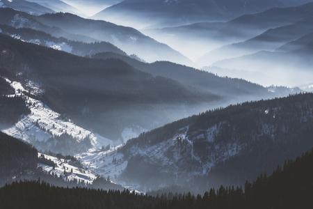 Bistrita valley covered in low fog on a warm winter day Foto de archivo