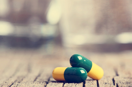 psychologists: Pharmacy background. Pills on a wooden table. Medicine. Natural background. Capsule. close up