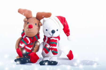 Snowman, reindeer and christmas decorations. Merry christmas concept. Stuffed toys Stock Photo