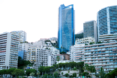 Monaco, Europe - August 16, 2017 City during sunset. International business center Monaco. Sun is shining through hotels and business buildings. Editorial