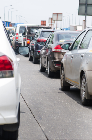 Cars on the road in traffic jam. Traffic situation in the Mumbai city. Pollution situation in India.