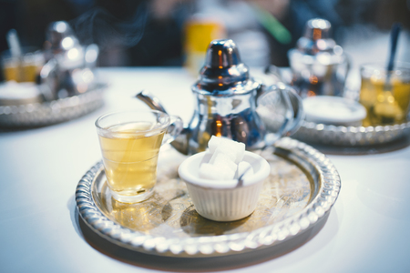 Traditional Moroccan mint tea with sugar in the restaurant.