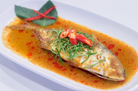 chili's restaurant: deep fried whole fish with sweet sour and hot sauce in white dish Thai food
