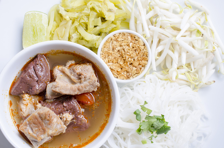 tangy: Rice noodles with spicy pork sauce Nam ngiao is a noodle soup or curry of the cuisine of the Tai Yai people. Nam ngiao has a characteristic spicy and tangy flavor.