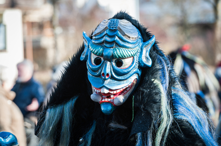 fasnet: Herrenberg, Gemany - February 21, 2012: Local Carnival Parade with traditional wooden masks also known as Swabian-Alemannic carnival.