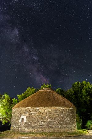 O Cebreiro, Spain. Historic stone hut and the milky way