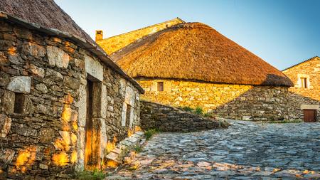 O Cebreiro, Spain. Historic stone huts at sunset Stock Photo