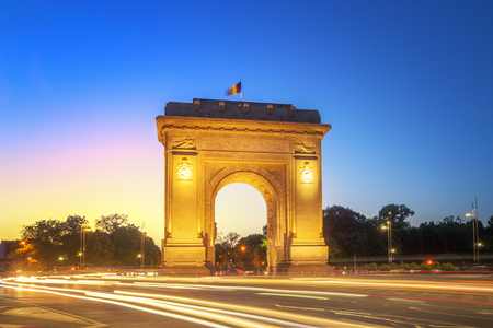 Bucharest, The Triumphal Arch (Arcul de Triumf) at dusk