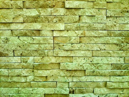 Natural stone wall. Light brown .  Stock Photo - 24502769
