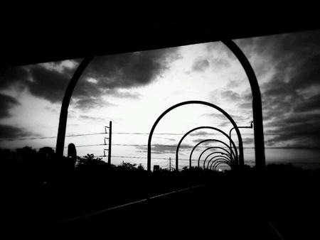 pedestrian bridge: Black and white pedestrian bridge.