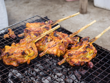 Grilling chicken plugged with bamboo, Thai street food