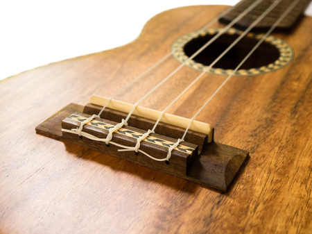 acoustic ukulele: Close up  shot of Ukulele bridge, acoustic guitar Hawaii style  Stock Photo