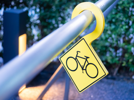 bike parking: Yellow bike parking sign in the park