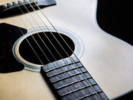 boehm flute: Close up shot sound hole and strings of acoustic guitar Stock Photo