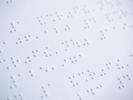 braille: Close up of braille text paper.