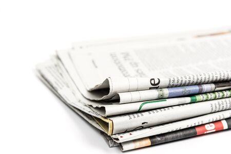 Stack of newspaper on white background. Image with clipping path.