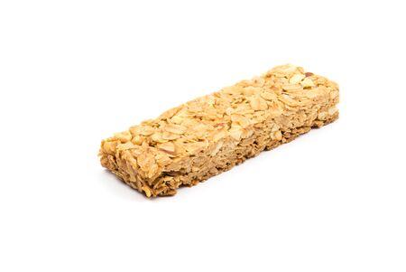barra de cereal: La harina de avena, almendras y miel barrita de cereales aisladas sobre fondo blanco Foto de archivo