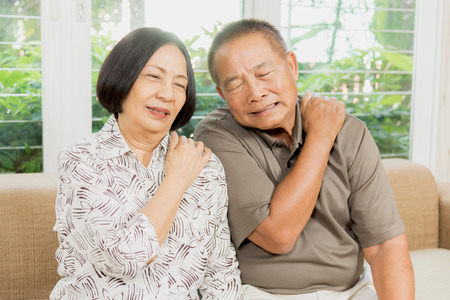 senior man on a neck pain: Senior asian couple having back and neck pain problem.