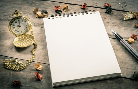 empty: Empty notepad for your content, pen and vintage old pocket watch on wooden background Stock Photo