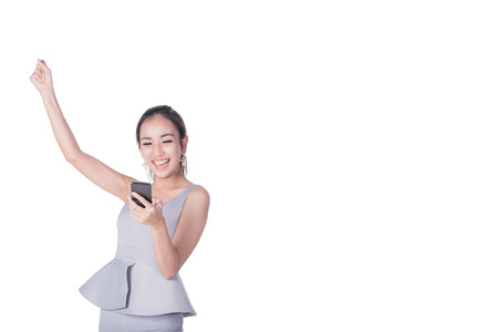 excite: Potrait of young happy beautiful Asian woman arm up to celebrat and excite while holding smartphone mobile. Image with clipping path