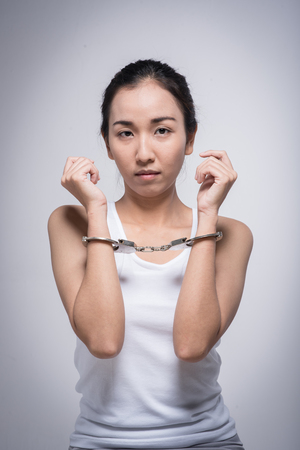 Sad woman with handcuffs.Stop Violence and abuse with woman concept. Stock Photo