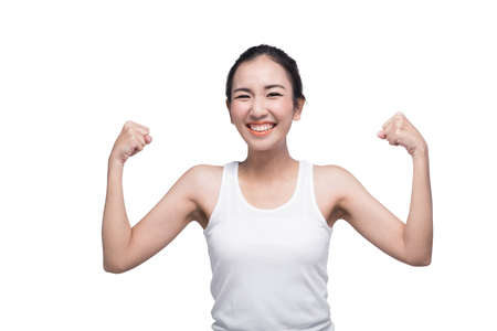 strong women: Beautiful strong confidence Asian woman shows her muscle isolated on white. Healthy concept. Stock Photo