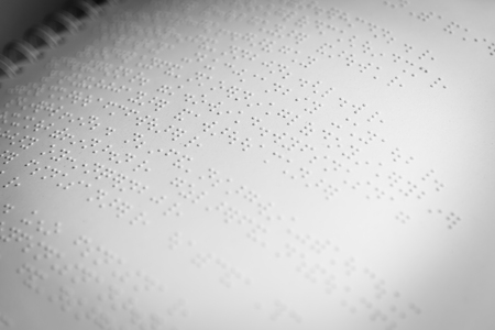 braille: close up page of braille alphabet in white paper.