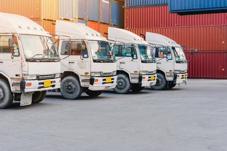 Line of cargo truck with container box for export import shipping at yard. logistic concept Stock Photo