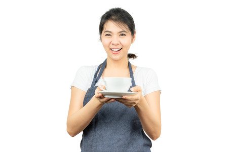 Smiling Asian Waitree or barista in apron holding coffe cup isolated on white background