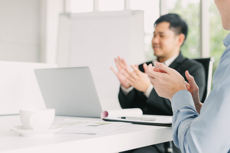 Hand of businessman applauding after success business meeting presentation