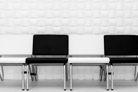 interior design of modern black and white chairs on white pattern wall