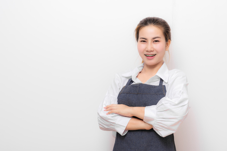 Happy Asian woman with apron on white background. Banco de Imagens