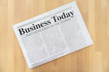 Top view of business newspaper on wooden background Banco de Imagens