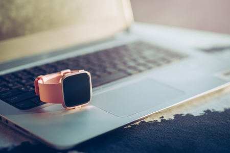 Close up shot of smartwatch on laptop Stock Photo