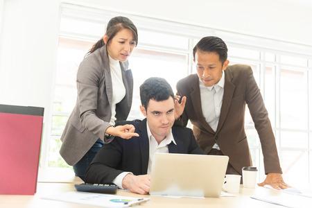 Business people blaming depressed caucasian man colleague in office. Zdjęcie Seryjne - 123581605