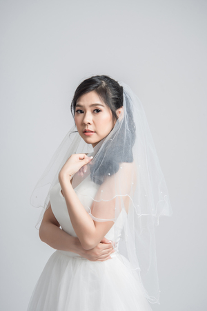 Beautiful portrait bride with veil on white background