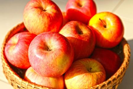 Apple gala in the handicraf basket Stock Photo - 17521859