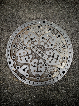 fragment manhole cover in japan photo